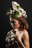 Easter woman with hat from carton box,  eggshells and flowers Stock Images