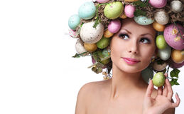 Easter Woman. Portrait of Beautiful Model with Colorful Eggs. royalty free stock photos