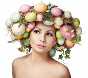 Easter Woman. Portrait of Beautiful Model with Colorful Eggs. Stock Photos