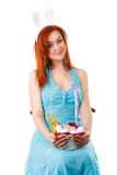 The easter woman a rabbit with a basket of eggs and pasky in hands. isolated. Stock Photos