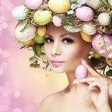 Easter Woman. Spring Girl with Fashion Hairstyle.. Portrait of Beautiful Model with Colorful Eggs Stock Photography