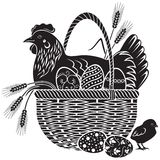 Easter woodcut. Hen sitting in a wicker basket with easter eggs Royalty Free Stock Image