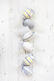 Easter wooden background with colorful eggs. Yellow and gray Royalty Free Stock Photography