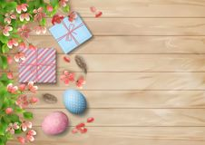 Easter Wooden Background. With gifts, eggs, blossoming tree branches, feathers. Vector top view illustration Stock Image