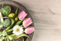 Easter wooden background with painted eggs and spring flowers Royalty Free Stock Images