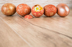 Easter wooden background with row of colored eggs, text space Royalty Free Stock Image