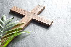 Easter wooden cross on black marble background religion abstract palm sunday concept. Closeup stock image