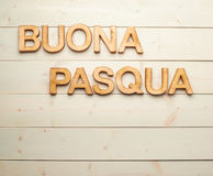 Easter wooden letter composition. Words Buona Pasqua as Happy Easter in italian language made of wooden letters as a festive Easter background composition royalty free stock photos