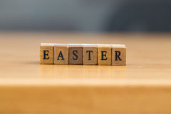 Easter. word written on wood block Royalty Free Stock Photo
