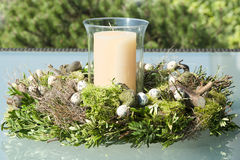 Easter wreath with candle on  garden table Stock Photo