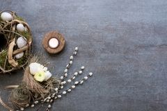 Easter wreath, catkins, tulips and candle arranged on a slate pl Stock Photo