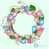 Easter wreath of colored eggs and flowers Royalty Free Stock Photography