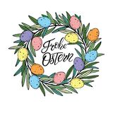 Easter wreath with colororful quail eggs with Happy Easter text lettering in German language. Royalty Free Stock Photography