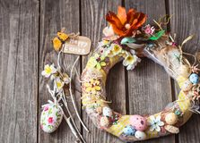 Easter wreath with decor. On a wooden background, concept of Easter holidays Stock Image