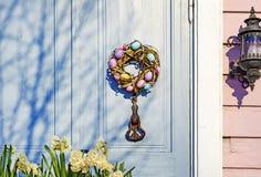 Easter wreath on the door. The door of the house.