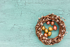 Easter wreath with Easter eggs on blue background Stock Image