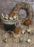 Easter wreath, eggs in a clay pot, brown eggs, quail eggs, chicken feathers, Royalty Free Stock Photography