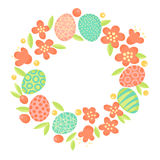 Easter wreath of flowers and painted eggs. Festive frame in vector Stock Photo