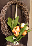 Easter wreath. Spring decoration on the wooden door of the house Stock Photography