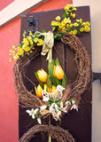 Easter wreath. Spring decoration on the wooden door of the house Royalty Free Stock Photos