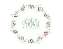 Easter wreath with stylized painted eggs isolated on white. Royalty Free Stock Image