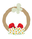 Easter wreath. Easter wicker wreath with flowers and a butterfly bow Royalty Free Stock Image
