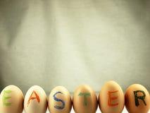 Easter written on eggs. Royalty Free Stock Photos