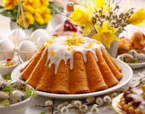 Easter yeast cake with icing and candied orange peel, delicious Easter dessert. Traditional Easter pastries in Poland Royalty Free Stock Photos