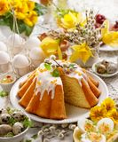 Easter yeast cake with icing and candied orange peel, delicious Easter dessert. Traditional Easter pastries in Poland Royalty Free Stock Images