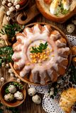 Easter yeast cake with icing and candied orange peel, top view. stock photos