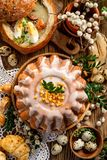 Easter yeast cake with icing and candied orange peel, top view. stock images