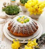 Easter yeast cake sprinkled with powdered sugar, decorated with marzipan eggs. Traditional Easter cake royalty free stock photos