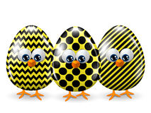 Easter yellow and black eggs  over white Stock Photos