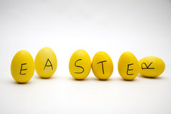 Easter yellow eggs. Easter letter on same yellow eggs Royalty Free Stock Photos