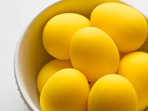 Easter yellow eggs in a bowl Stock Photos