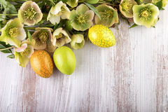 Easter yellow green decoration over light wood Royalty Free Stock Photography