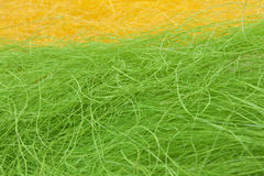 Easter yellow and green straw background Royalty Free Stock Photography