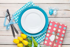 Easter with yellow tulips, colorful eggs and gift box Royalty Free Stock Images