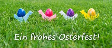 Greeting card for a Happy Easter. Eastercard with colorful Easter eggs with german text: A Happy Easter Royalty Free Stock Images