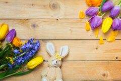 Easter decorations, Easter Bunny and flowers on wood royalty free stock image