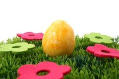 Easteregg on grass. One eastereg on grass on white background Stock Photos
