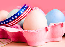 Eastereggs in a box. Easter eggs in a box with an american bow Royalty Free Stock Photo