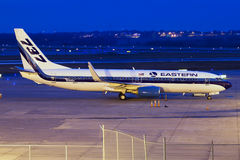 Eastern Airlines 737 at Night. Eastern Airlines Boeing 737-800 at Des Moines, Iowa Stock Photo