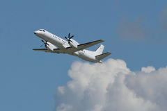 Eastern Airways Saab 2000 climbs in the sky Royalty Free Stock Images