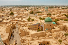 Eastern architecture. Central Asia. The ancient city of Khiva with the bird's eye view. View of the city of Khiva from the top of the turquoise roof of the Stock Image