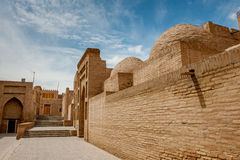 Eastern architecture. Central Asia. The ancient city of Khiva. Street of the ancient city of Central Asia - Khiva. Yellow brick wall, a cobbled street, a small royalty free stock images