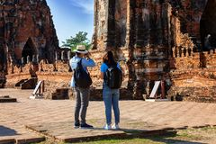 Eastern Asia summer holidays. Caucasian man and Asian woman tourist from back looking at Wat Chaiwatthanaram temple. Tourist. Eastern Asia summer holidays royalty free stock photos