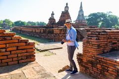 Eastern Asia summer holidays. Caucasian man tourist from back looking at Wat Chaiwatthanaram temple. Tourist travel in the morning. At temple in old city of royalty free stock photo