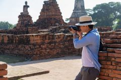Eastern Asia summer holidays. Caucasian man tourist from back looking at Wat Chaiwatthanaram temple. Tourist travel in the morning. At temple in old city of stock images