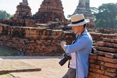 Eastern Asia summer holidays. Caucasian man tourist from back looking at Wat Chaiwatthanaram temple. Tourist travel in the morning. At temple in old city of royalty free stock photography